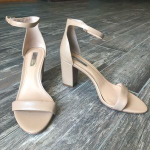 Tan INC heels with a strap around ankle